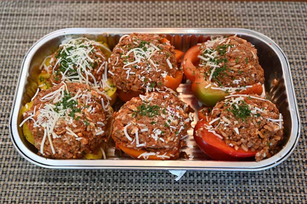The tray of stuffed peppers with the lid removed, before cooking.