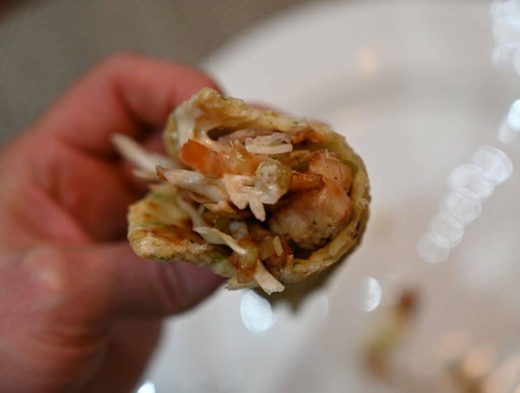 Costco Chicken Yakitori Flatbread closeup of flatbread prepared and with a bite out of it