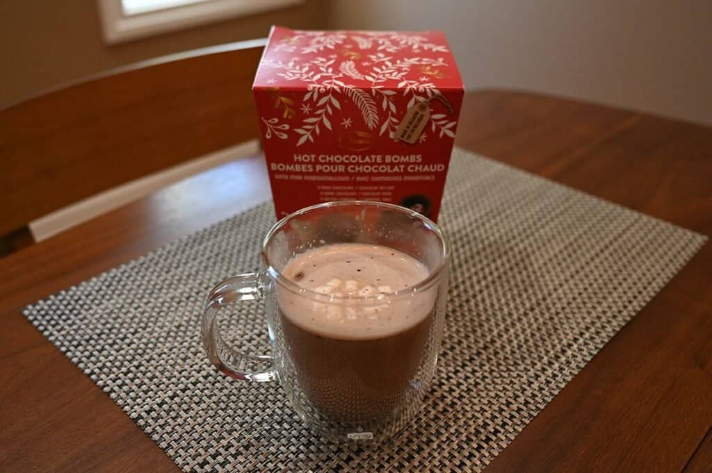 Costco Deavas Hot Chocolate Bombs hot chocolate in a mug in front of the box