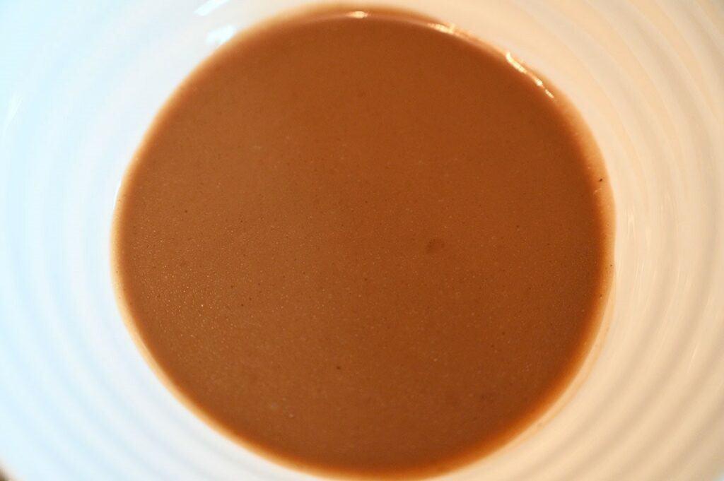 Costco Johnny's Black Garlic Vinaigrette  poured in a bowl