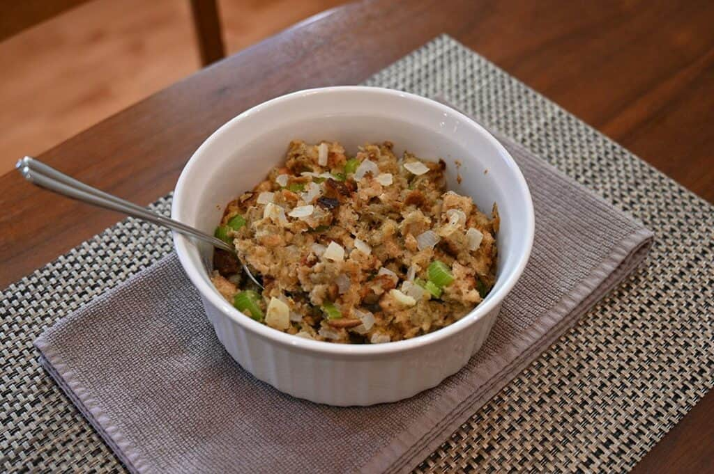 Costco Back to Nature Gourmet Stuffing Mix prepared in baking dish with spoon sitting in it